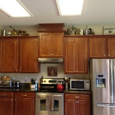 Coffee-themed decor above cabinets