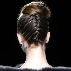 Chignons, ponytails, and more updos dominated New York Fashion Week. Here, hairstylists share the secrets to re-creating the styles at home.