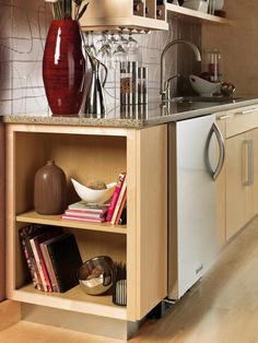 Turn It the Other Way  Make use of wasted space. Open shelving can be a great way to put to work a spot that otherwise might have languished. The small double shelf tucked at the end of this kitchen countertop offers just enough room to store cookbooks and decorative flotsam, and it also gives the space a more graceful, less clunky look. Courtesy of Merillat