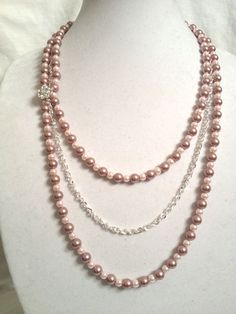 Pink and Mauve Pearl Necklace with Silver Chain and a Crystal Broach. $60.00, via Etsy.