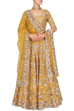 a mango colour lehenga in raw silk fabric with hexagon and flowers sequins embroidery all over. It comes along with mango colour blouse in raw silk fully embroidered with sequins and zari. It has a yellow dupatta in net with sequins chitta and embellished border. .For this lehenga mail us at contact@ladyselection.com