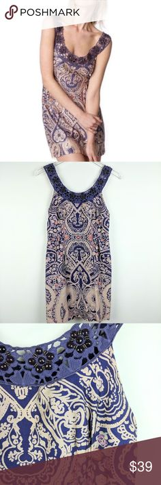 """Free People Purple Beaded Mini Dress Festival Boho Free People Purple Beaded Dress Festival Boho.  Super cute dress, great for upcoming festivals or for a night out.  Beaded crochet trim, size zip.  Lined.  There is a faint coffee stain near the hem, shown in photo #4.  Size 0.  Measurements are taken with the garment lying flat and unstretched:  Armpit to armpit:  16.5"""", Total length:  33""""  Smoke free home.  Thanks for stopping by!  C60 Free People Dresses Mini"""