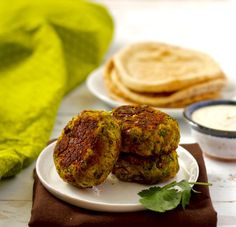 Easy baked falafel and a simple tahini sauce - bright, fresh Mediterranean flavors! | FamilyFoodontheTable.com