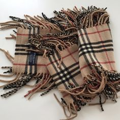 Details to come! Authentic Burberry Cashmere Scarf In Excellent condition. Only used once. (The last pic is just a reference for one of the many happy ways you can dress up with this scarf ❤️❤️Super soft and 100% Cashmere from London. Simple, timeless yet a real fun piece. This color doesn't go out of style. Perfect for all seasons! Burberry Accessories Scarves & Wraps