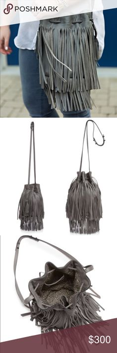 "Loeffler Randall Industry Fringe Bucket Bag No trades! Take on two trends in one impossibly cool carryall: Long layers of fringe make Loeffler Randall's already-irresistible bucket bag even more alluring. Leather Imported Top handle, detachable adjustable crossbody strap Drawstring closure; lined Two interior slip pockets 6.5""W x 6.5""D x 10""H; 8"" handle drop, 22"" strap drop Loeffler Randall Bags Crossbody Bags"