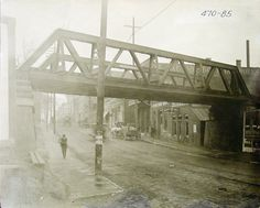 Market Street (now Highland) looking south towards downtown in 1918. This old railroad overpass has been removed.