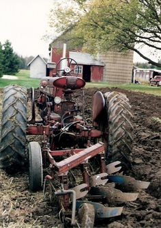 Nice pic of Farmall 450 with  plow.