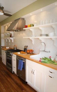 Do you like open shelving in the kitchen? This 200 sq. foot kitchen has open shelving to reduce the visual impact and space regulations of upper cabinets.
