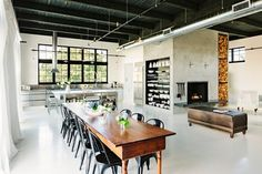 SE Division Street - industrial - dining room - portland - Emerick Architects.  crate and barrel has chairs like these on sale right now.  possible option?  how comfortable are they?