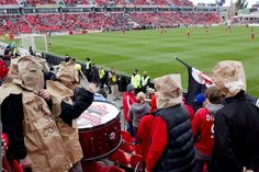 Toronto FC fans wear paper bags as a protest against the team's performance during their 1-0 defeat to D.C. United in MLS action in Toronto on Saturday, October 6, 2012. After a disastrous season, Toronto FC is trying to win back fans by slashing season ticket prices.The Major League Soccer team is rolling back prices for all past and current ticket holders to 2007 inaugural season levels. THE CANADIAN PRESS/Chris Young