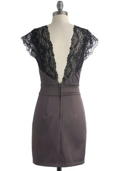 Taupe-grey ModCloth sheath, rear view. 2-panel black lace cap-sleeves, V-neck, and deep-V back; grey sweetheart neck; wide waistband at natural waist, and front and rear princess darts; and fingertip-length skirt with princess pleats and back zipper. Make in grey velvet! 65% polyester/32% cotton/3% spandex (satin), $49.99