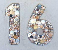 Seashell House Numbers: http://www.completely-coastal.com/2013/08/house-garden-walls-beach.html These seashells are set into the wall. Gorgeous!