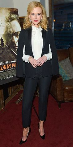 NICOLE KIDMAN Nicole puts a dramatic spin on the menswear trend, topping off her stovepipes with a bow blouse and a caped tuxedo jacket at a screening of The Railway Man in L.A.