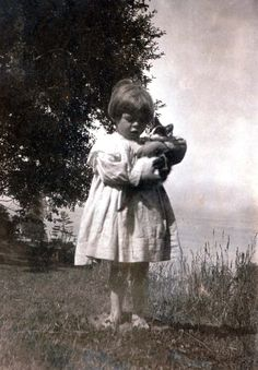 Some things never change … . just, awww. 1904, a girl and her kitty.