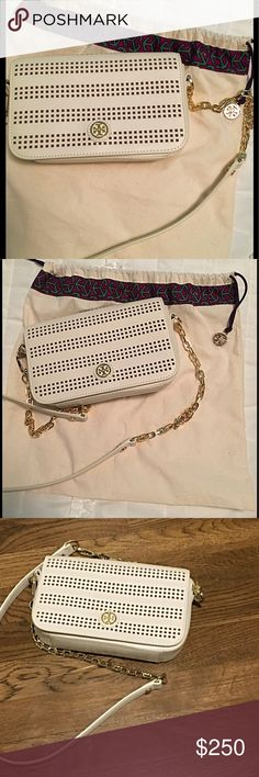 Tory Burch Robinson perforated cross body bag Tory Burch like new bag only used once looks brand new inside and out . Gold chain and leather strap can be worn cross body or over shoulder dressy or casual. Also great as a clutch.  Perfect summer bag!                          ***DUST BAG INCLUDED*** Tory Burch Bags