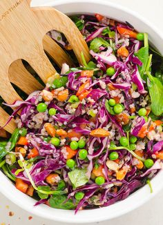 Red cabbage, spinach, almonds and peas are tossed together with quinoa, rice in a homemade Thai dressing.