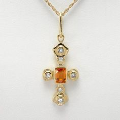 14Kt Gold Diamond and Mandarin Garnet Cross Necklace by Donna Pizarro from her Collection of Fine Jewelry and Fine Cross Jewelry