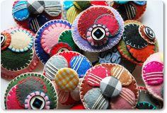 felt brooches=====interesting embroidery on felt and yo-yos