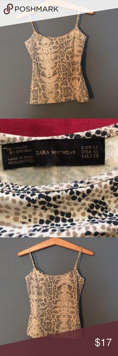 Zara Knitwear tank top size M 92% nylon 8% spandex Zara Knitwear tank top size M 92% nylon 8% spandex. Color is beige tan and black too cute Zara Tops Tank Tops