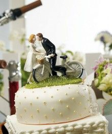 """// """"A Kiss Above"""" Bicycle Bride and Groom Couple Figurine Wedding Cake Toppers"""