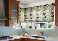 #Prints are in! This is a beautiful example of printed fabric shades in the kitchen. #shades #printedshades #kitchenwindows
