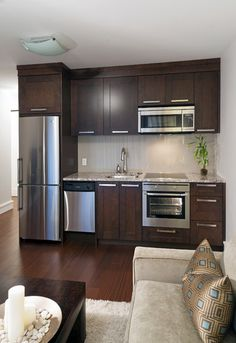 Less than 9 feet wide, this kitchenette packs lots of options for cooking and food storage into a very practical footprint. It includes a co...