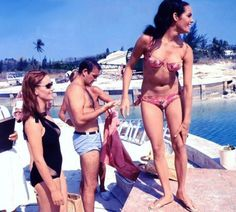 Claudine Auger, Sean Connery, and Martine Beswick on the set of Thunderball (1965) - filmed in the Bahamas.