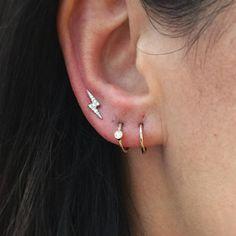 Starting off the day right with this fresh 2nd lobe and upper lobe piercing ⚡️ Pierced at @maria_tash @libertylondon    Diamond Lightning Bolt