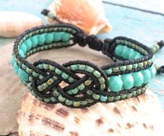 Beaded Josephine Knot Bracelet, Leather Beaded Cuff, Turquoise Jewelry, Adjustable Bracelet, Knot Cuff, Knot Bracelet, Unique Jewelry  New Sunset Southpaw design! Featuring 6mm Turquoise Fire Polished beads and 8/0 Opaque Turquoise Picasso Seed beads handwoven onto black leather cord with a beaded Josephine knot in the center. This unique and beautiful bracelet has a sliding knot closure for an adjustable fit.  Measures about 7 inches fully closed and is a little over .5 inch wide.  **All…