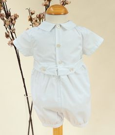 Only available at Tots & Frocks, this adorable romper is perfect for Christenings, Naming Days, Baptisms, weddings and special occasions. A smart fully lined all in one with short sleeves and legs. The romper has a pin tuck and embroidered pattern on the chest and piped detail on the front of each leg. It has a button fastening at the rear to the small of the back and on the legs for ease of changing.