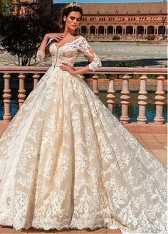 Buy discount Lavish Tulle & Satin V-Neck Ball Gown Wedding Dresses With Lace Appliques at Laurenbridal.com