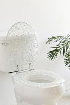 A metallic-flecked toilet seat that — ummm — is honestly gorgeous. A toilet seat that's. I didn't think such a thing existed yet here we are! 28 Beautiful Versions Of Things You Use All The Time Bathroom Sets, Small Bathroom, Bathrooms, Bathroom Plans, Toilet Storage, Bathroom Storage, Shower Accessories, Tissue Box Covers, Covered Boxes