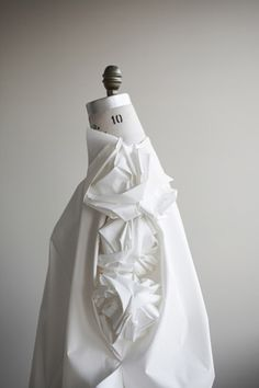 Innovative Textiles Design - origami dress that mechanically folds fabric when touched - interactive fashion; fabric manipulation // Ying Gao