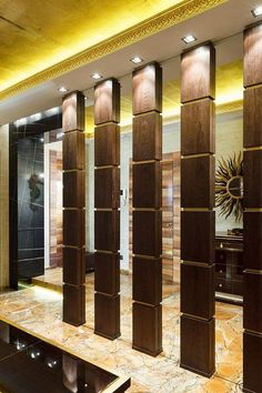 To create a more private or cozy space in your home, a divider is a perfect thing. Wooden Partition Design, Wooden Partitions, Living Room Partition Design, Room Partition Designs, Wooden Door Design, Living Room Divider, Columns Decor, Interior Columns, Lobby Interior