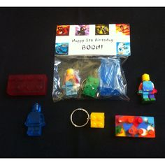 PreSchool goody bags for my sons class which may not contain food. Each bag contained a lego themed piece of soap, a crayon and a key chain. Had to make the bag topper myself and used a free ninja font :-)
