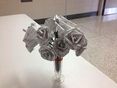 Flower arrangement made out of sheet music.