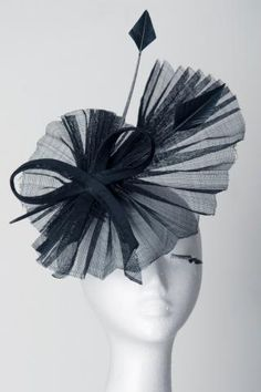 Black pleated sinamay and ribbon fascinator.Perfect Ladies hat and fascinator racewear fashion statement