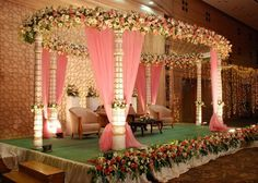not digging the colours or floral design- but mandap structure could work for both wedding and reception with different floral decor and drapes- good usage of stage space