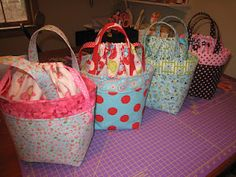 "Easter ""baskets"".  I can't wait to give them out.  Made from this tute: http://ayumills.blogspot.com/2010/08/tutorial-lunch-bag.html"