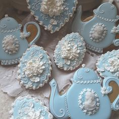 Gingerbread keepsake cookies for a tea party decorated with royal icing and fondant cameos