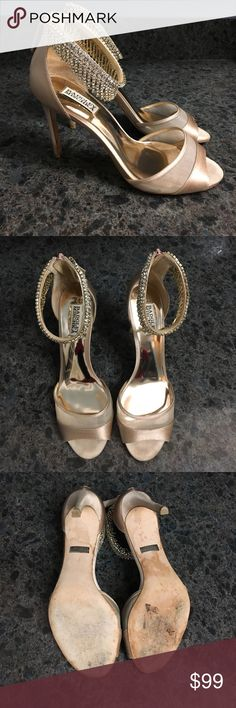 "Badgley Mischka Gazelle Size 9 Bone satin heel Badgley Mischka Gazelle Size 9 bone/cream color in satin & mesh trim.  Beautiful ankle strap rhinestone trim. Worn once!!! 4"" heels .  Please note very slight discoloration in picture at ends of heels. Nearly perfect condition.  Great for bride or bridesmaid. Badgley Mischka Shoes Heels"