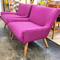 Pair Heywood-Wakefield chairs with reuupholstered new Knoll raspberry fabric.