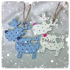 Handmade personalised Christmas wooden reindeer decoration.