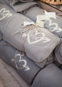 Monogrammed fleece throw blankets as a wedding favor to your guests. Especially good idea for fall or winter weddings, or an outdoors wedding in case it gets chilly