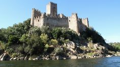 The Castle of Almourol is a medieval castle, located on a small islet in the middle of the Tagus River, in the civil parish of Praia do Ribatejo, 4 kilometres (2.5 mi) from the municipal seat of Vila Nova da Barquinha, in the Portuguese Centre Region. The castle was part of the defensive line controlled by the Knights Templar, and a stronghold used during the Portuguese Reconquista. Built c. 1171