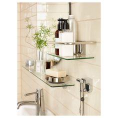Ikea Kalkgrund Bathroom Glass shelves on a white tiled wall Glass Shelves Ikea, Bathroom Shelves Over Toilet, Rustic Bathroom Shelves, Bathroom Storage Shelves, Floating Shelves, Bathroom Organization, Organization Ideas, Storage Ideas, Organized Bathroom