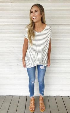 Chase-Ivory. White and black striped faux knot tee with jeans and sandals. White and black striped tee. Faux knot tee.