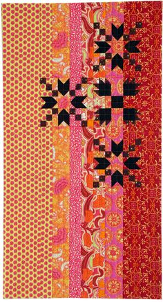 Indian Summer by Ginnie Hebert. Editor's Choice Award. 2013 Traditional to Modern Quilt Challenge at Quilters Newsletter