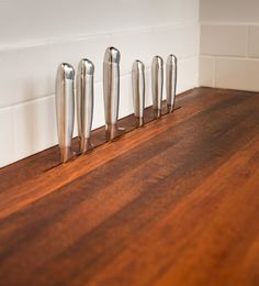 In-counter knife storage. Removes the look of a freestanding knife block but keeps knives close at hand. Austin, Texas, woodworker Daniel Vos of DeVos Custom Woodworking says he custom makes these slots in new wood countertops that he also fabricates.