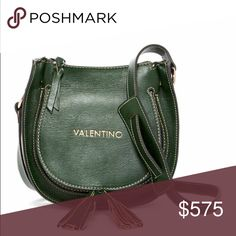 💚Valentino deep green crossbody Truly beautiful bag in deep green leather! Comes with authentication card and dust bag. I almost want to keep this one all to myself! Under the front tasseled flap is a suede faced pocket. Interior has a zip pocket and a slide pocket for phone or to keep the authenticity card. Buckle on the strap allows for length adjustment. Valentino Bags